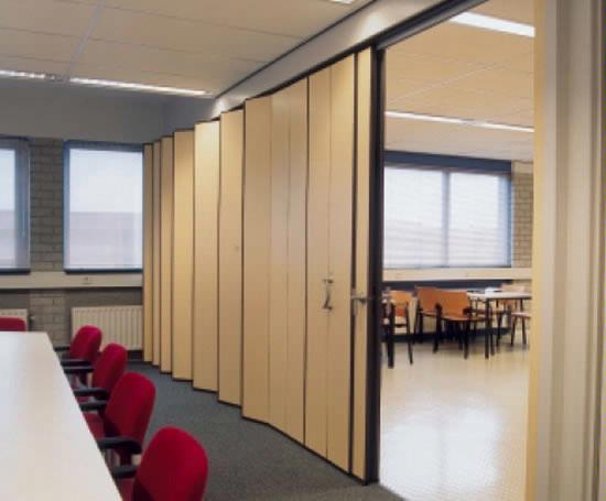 Acoustic doors including movable wall systems and folding for Acoustic folding partitions